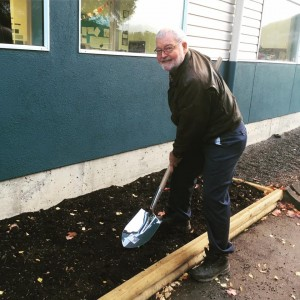Jim Mantel Sr. planting tulip bulbs, in memory of his father Jacob Mantel who donated his farming land so Centennial Christian School could be built!